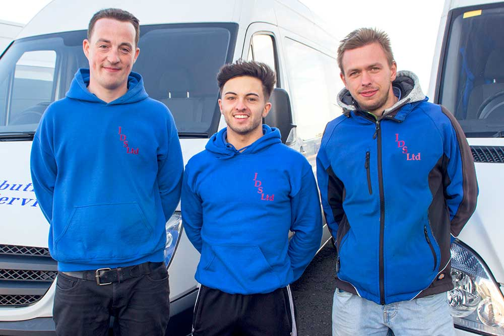 3 Workers with Distribution Vans